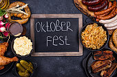 Oktoberfest dishes with beer, pretzel and sausage