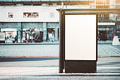 A blank poster mockup outdoors