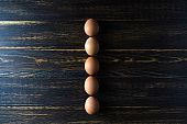 Fresh eggs on wooden table