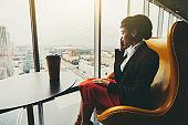 Businesswoman on golden armchair