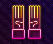 Glowing neon line Medical rubber gloves icon isolated on black background. Protective rubber gloves. Vector