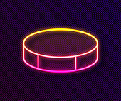 Glowing neon line Hockey puck icon isolated on black background. Sport equipment. Vector Illustration