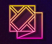 Glowing neon line Folded map icon isolated on black background. Vector Illustration