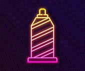 Glowing neon line Sewing thread on spool icon isolated on black background. Yarn spool. Thread bobbin. Vector Illustration