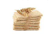 Wheat round crispbread, crunchy multigrain cereal seeds isolated on white background, healthy eating