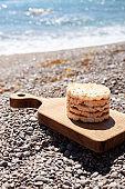 Round Crunchy Crispbreads On Cutting Board. Seaview.