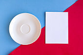 Empty plate and mockup blank on red and blue geometric background. Copy space for the text. Minimal concept