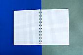 Open mockup notepad on color background, copy space for the text