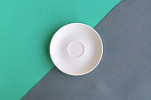 Empty plate on grey and green background. Copy space for the text. Minimal concept