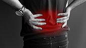 man suffering from backache,Lower back pain