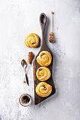 Sweet swirl buns with raisins for breakfast