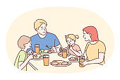 Happy family having dinner or breakfast together at home
