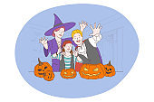 Celebrating Halloween holiday in spooky costumes concept