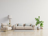 Bright and cozy modern living room interior have sofa and lamp with white wall background.