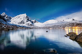 Lofoten islands, Norway. Panoramic landscape. Long exposure photography. Reflection on the water. Winter landscape at the night time. Norway travel - image
