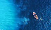 Croatian seascape with boat. Yachts at the sea surface. Aerial view of luxury floating boat on blue Adriatic sea at sunny day. Travel - image