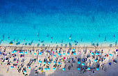 Croatia. Aerial view on the beach with umbrellas. Beach and azure water. Summer background. Travel and relax - image