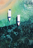 Boats on the beach from top view. Water background from drone. Summer seascape from air. Bali, Indonesia. Travel - image