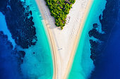 Croatia, Hvar island, Bol town. Aerial view at the Zlatni Rat beach. Famous place in Croatia. Summer seascape from drone. Travel - image