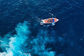 Aerial view of floating ship on blue Adriatic sea at sunny day. Fast ship on the sea surface. Seascape from the drone. Travel - image