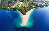 Croatia, Hvar island, Bol. Aerial view at the Zlatni Rat. Beach and sea from air. Famous place in Croatia. Summer seascape from drone. Travel - image