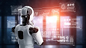 Thinking AI humanoid robot analyzing hologram screen showing concept big data
