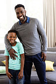 African man and his son enjoying their time at home during coronavirus covid19 pandemic