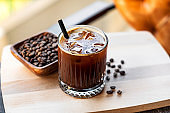 Cold brew coffee with milk and ice cubes in glass