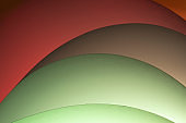 Red and green paper sheet waves