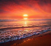 beautiful red sunset on beach with big sun