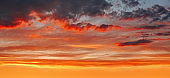background of cloudscape with beautiful red sunset clouds on sky