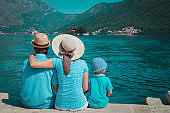 happy family with small child looking at scenic view on Kotor bay, Montenegro
