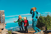 happy kids enjoy travel in mountains, family vacation in nature