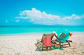 Two beach chairs on tropical vacation, travel to sea