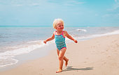 cute little girl going to swim at beach vacation