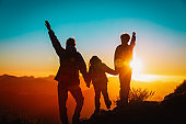 father with kids travel in sunset mountains, happy family in nature