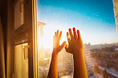 child stay home, kids on lockdown concept, baby hands on the window