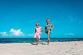 happy kids enjoy beach vacation, boy and girl have fun