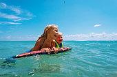 happy cute girls enjoy swim on beach vacation