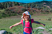 happy cute little girl enjoy hiking in nature, family travel