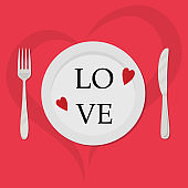Valentine's day concept. There are red hearts and the text Love on a plate