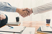 """Business Meeting agreement Handshake concept, Hand holding after finishing up dealing project or bargain success at negotiation over office background""""u2028"""