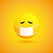 Sad, Concerned Crying Emoticon with Medical Mask