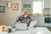 Stressed Elderly Man Calculating Home Finances