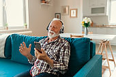 Excited old guy listening to music with headphones