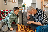 Grandfather and Grandson Playing Board Game