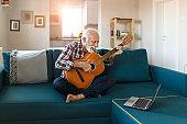Senior Man Play Acoustic Guitar