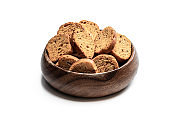 Mini toasts bread in wooden bowl isolated on white background