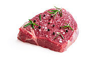 Raw beef steak with herbs and spices isolated on white