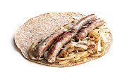 Super seeds wrap with sausages and onions cooking isolated on white